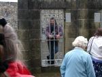 Tourguide hinter Gittern